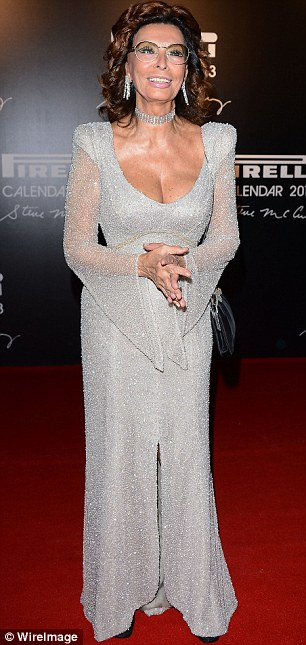 Simply stunning: The star teamed her glittering dress with diamond jewels and a black clutch bag