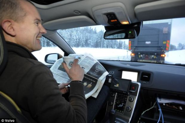 Volvo has already begun testing the technology. Here, a driver drinks tea as his car automatically drives itself, keeping a safe distance from the lorry in front
