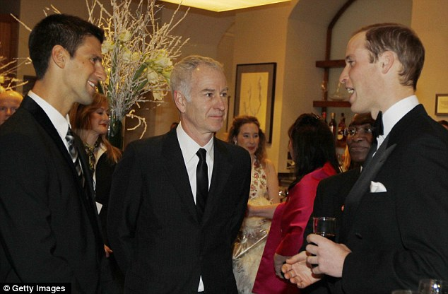 Prince William talks to tennis players Novak Djokovic, left, and John McEnroe, right, during the gala