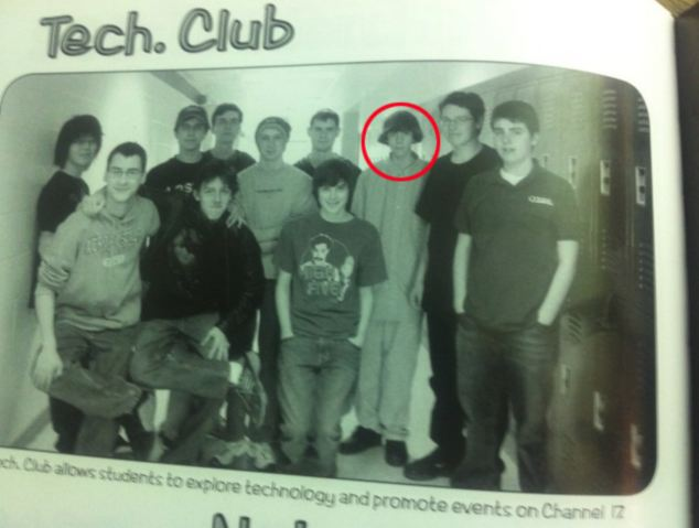 Adam Lanza, circled in red, in a photograph of his high school science club taken five years ago when the murder was 15 years old