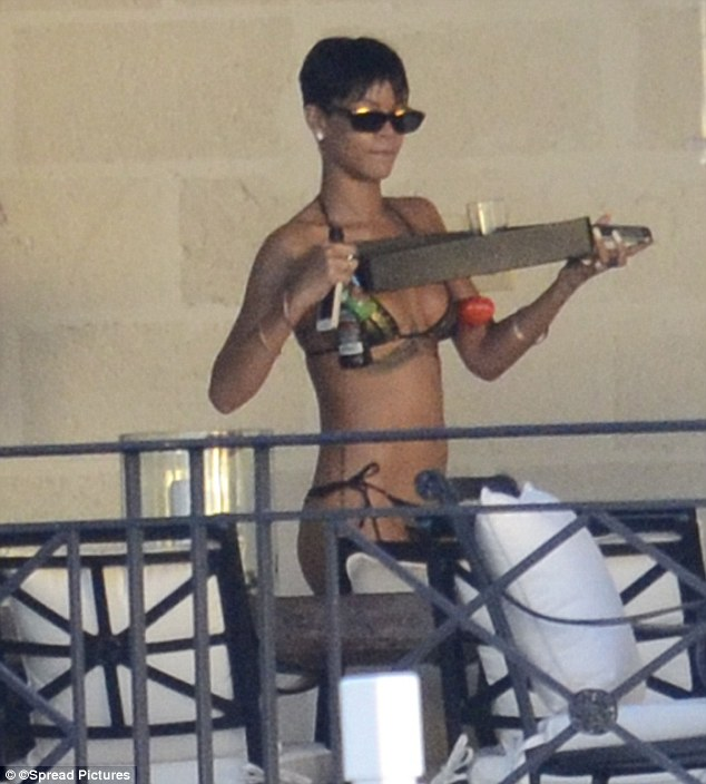 Treating herself: Rihanna was seen carrying a tray of food and drink, as well as her beloved iPhone