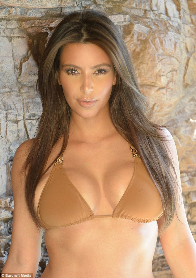 Dangerous curves: The reality star wears a skimpy tan bikini for the Miami photoshoot