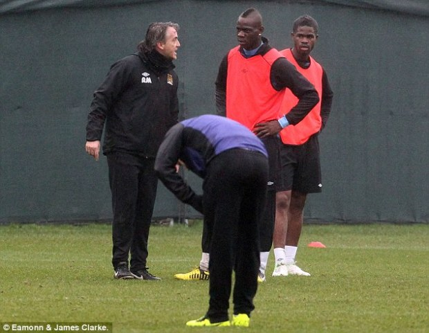 Tempers: Roberto Mancini was angry after a mis-timed tackle from Mario Balotelli