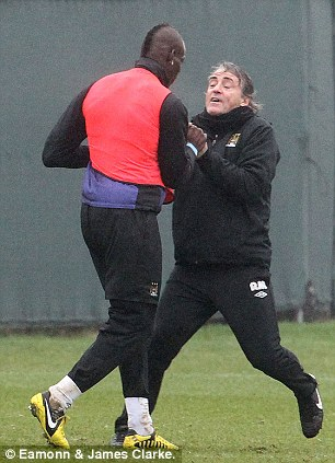 The manager and player grapple with each other
