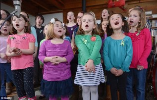 Healing process: The children who survived the Sandy Hook school shooting recorded a version of Over The Rainbow on the one-month anniversary of the tragedy on Monday