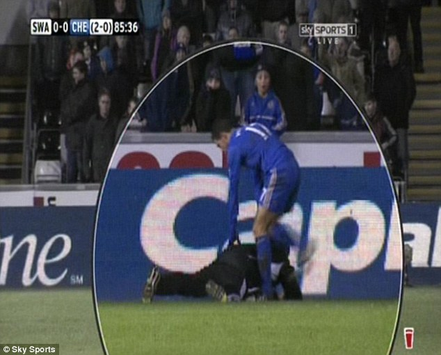 The moment: Chelsea striker Eden Hazard kicks a ballboy in the ribs during a match against Swansea City