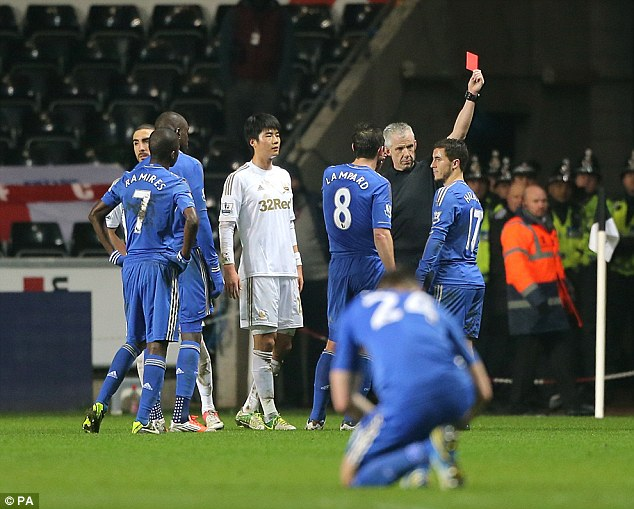 Sending off: Chelsea's Eden Hazard (#17) receives a red card from referee Chris Foy for violent conduct