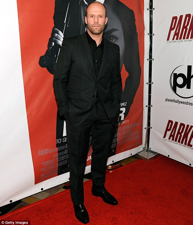 Suited and booted: Jason Statham looked smart as he promoted the film