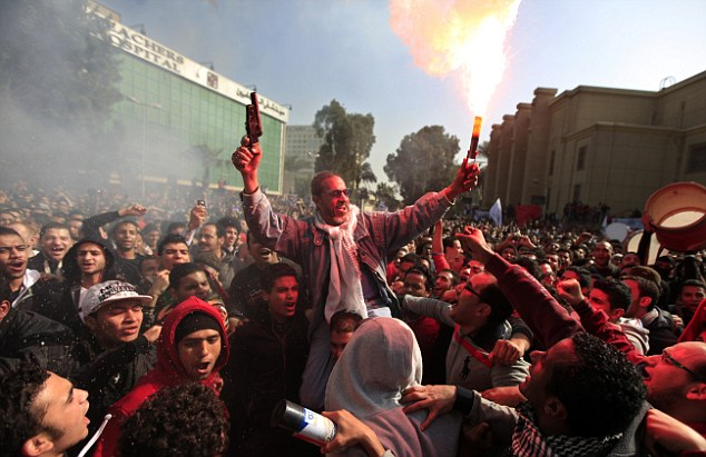Decision: Egyptian fans of Al-Ahly club, one of the clubs involved in the violence last year, celebrate as 21 people were sentenced to death for their part in the violence