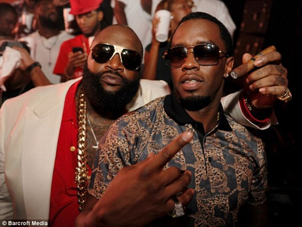 Narrow escape! Rick Ross and Sean 'Diddy' Combs pose for a photograph during his birthday celebrations at LIV, Fontainebleau in Miami Beach; the rapper was heading home from the bash when he was attacked in a drive-by shooting