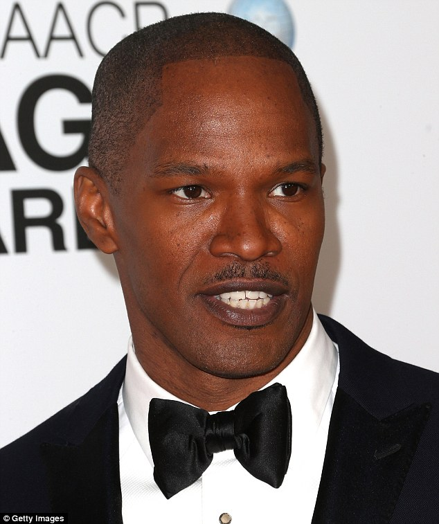 Dapper co-star: Her Django Unchained co-star Jamie Foxx who looked handsome in a classic black tux and bow tie. He was awarded Entertainer Of The Year