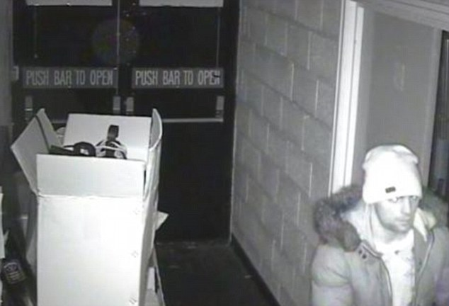 Shocking: CCTV cameras captured the gang stealing cash, champagne, beer and wine from the community centre venue last month