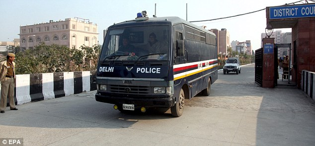 Accused: A Delhi police van, believed to be carrying the five accused men, leave a court last week