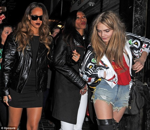 Long day: Cara seemed a little worse for wear as they emerged from The Box nightclub