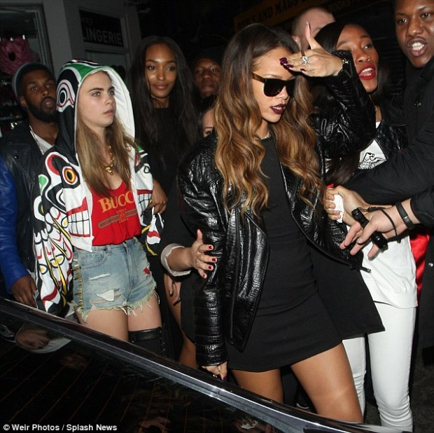 Feeling the pressure? Rihanna and Cara scramble past fans