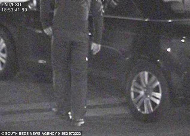Horrific: A man is pictured approaching the car of a young woman moments before he jumped into her car and sexually assaulted her at knifepoint