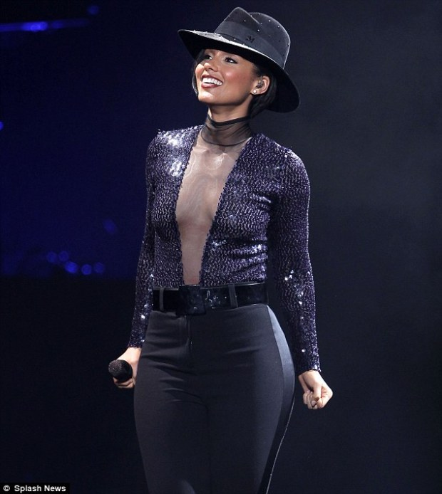 Showstopping: The 32-year-old singer flashed a hint of toned and taut midriff with just a tiny mesh overlay protecting her modesty