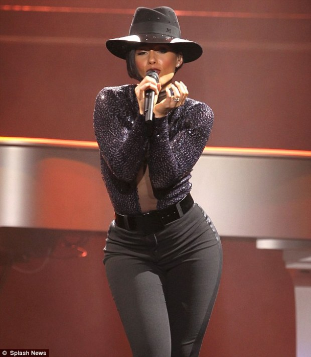 Fashion-forward: The star completed her stage ensemble with a stylish black felt fedora