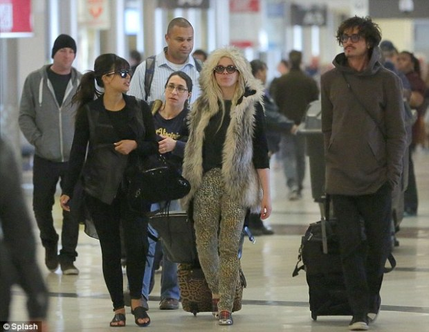 First night: Kim showed no nerves if she was anxious about her screening as she arrived at the airport with glam squad Joyce and hairdresser Clyde