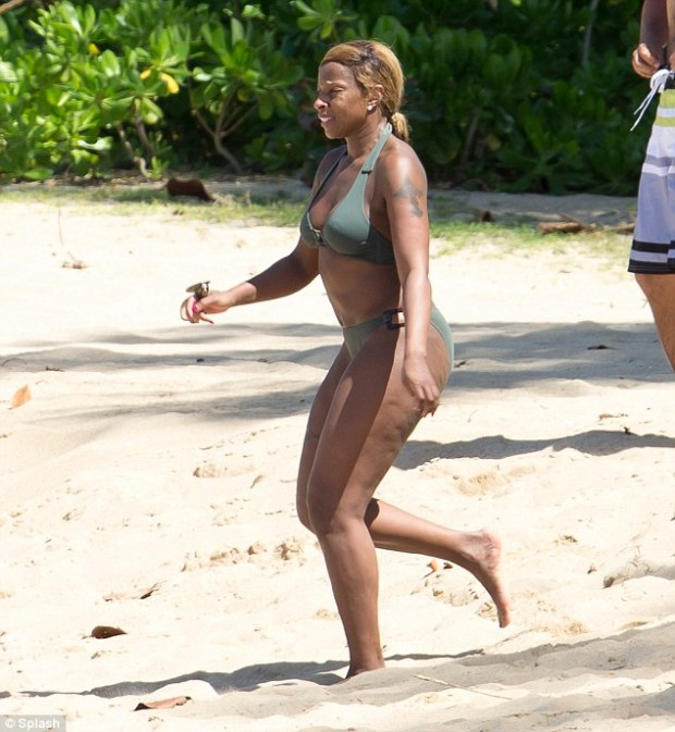 Much needed holiday: Singer and actress Mary J. Blige sported a sexy bikini on a beachfront break with her husband in Puerto Rico on Sunday