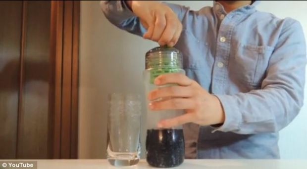 The water bottle with a filter developed from Nasa technology is filled with Coke as the experiment progresses