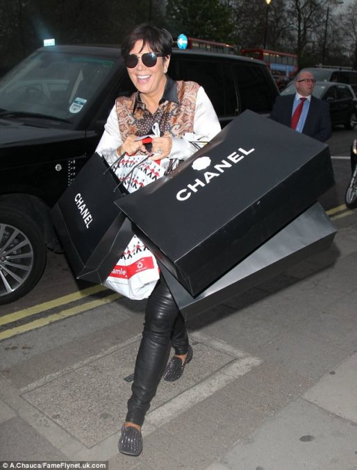 Oh la la: Kris returned to her hotel with several bags from the store 
