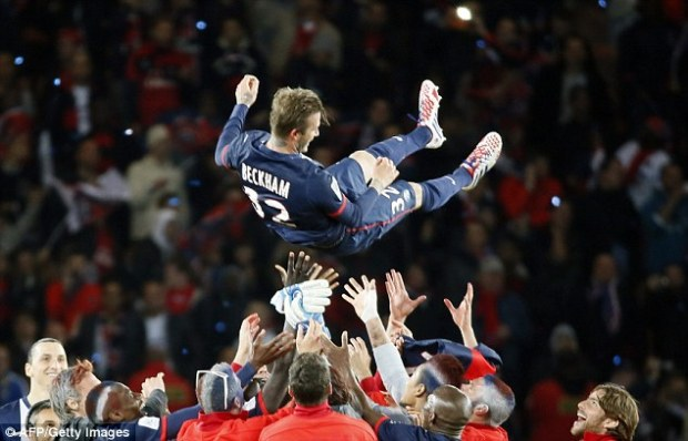 Afterparty: The celebrations began as Beckham was tossed in the air by his teammates after the game