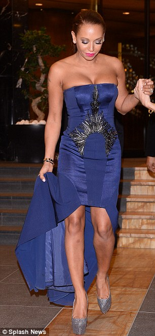 Squeezed: The Spice Girls dress could barely contain her chest as her cleavage spilled over the top