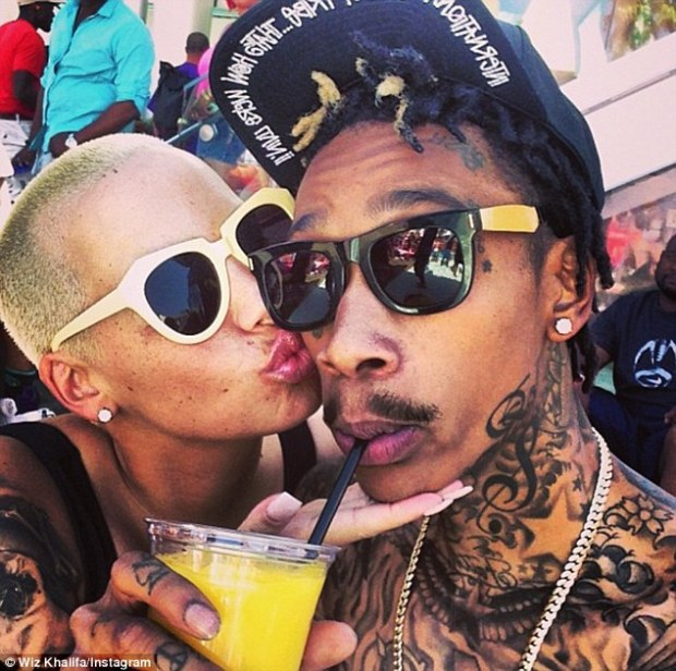 Affectionate duo: 'Now im at the pool wit my baby,' Wiz Khalifa posted with this snapshot of him and his fiancee Amber