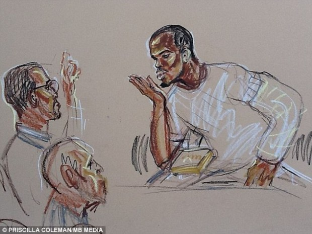 Gesture: Those in court said that Adebolajo apparently blew kisses to this man from the dock, the unnamed named then apparently pointed to the sky