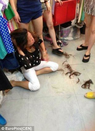 Lu Sun was helped by a fellow shopkeeper as she pinned the shoplifter down and hacked off her hair