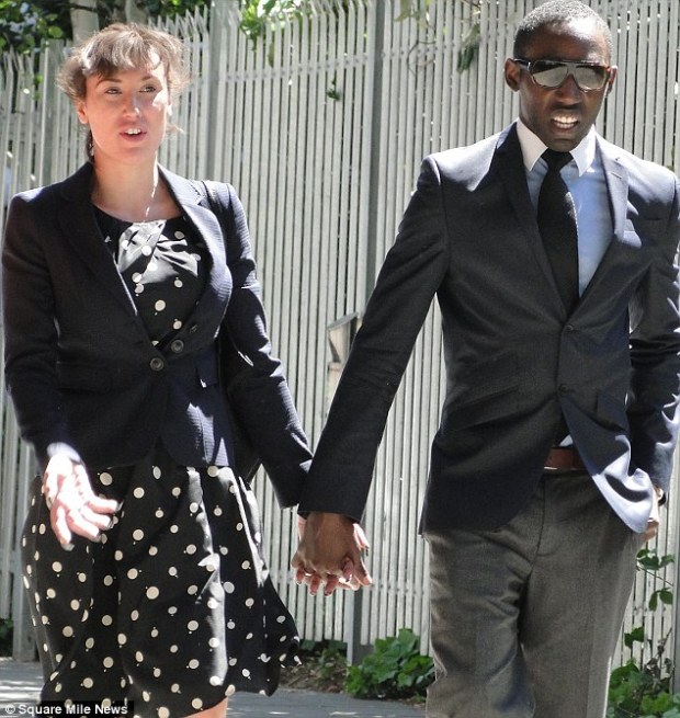 Rage: The model violently grabbed and kicked her husband and also pushed the manager of the Kensington Close Hotel in west London. Mr and Mrs Nwaiwu are pictured leaving court