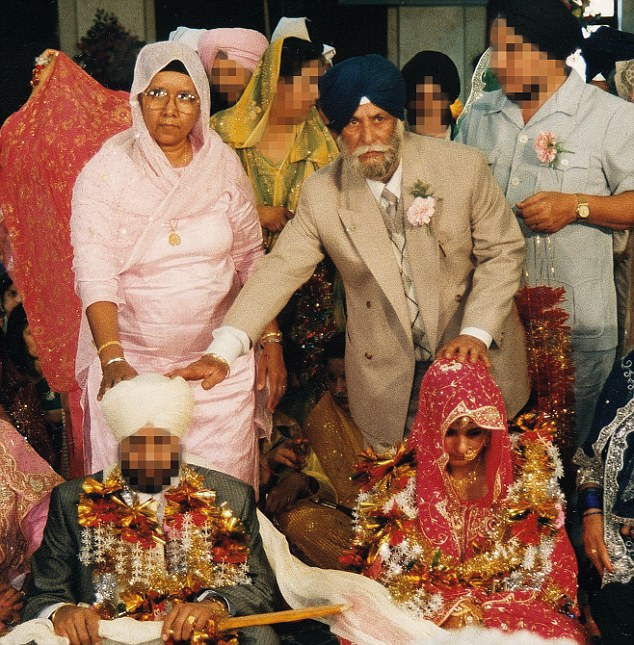 Sarbjit and her husband on their wedding day with her mother and father-in-law in the background. The mother controlled all of the men in the house