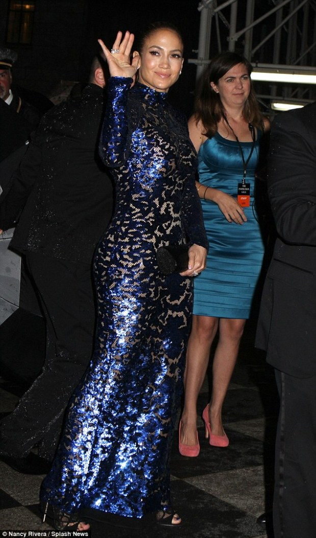 Shimmering: Jennifer Lopez wears a metallic blue Tom Ford gown to the fourth annual amfAR Inspiration Gala
