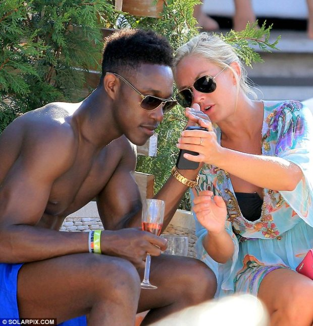 Rest and relaxation: Manchester United footballer Danny Welbeck was seen chatting to a blonde model on Fridaym while on holiday in Ibiza