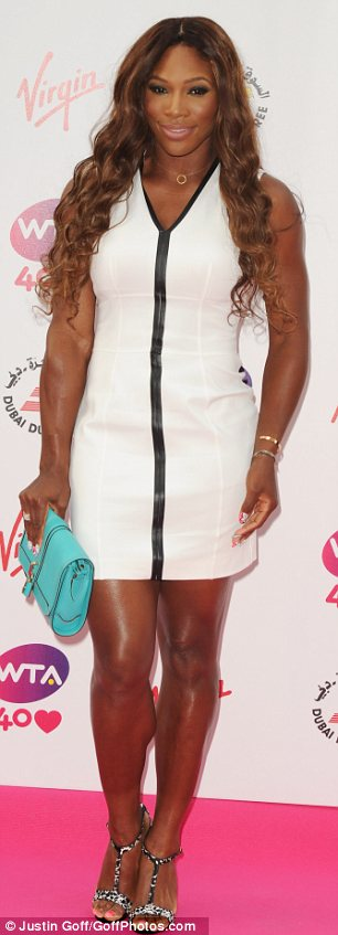 Scoring on and off the court: Serena Williams wore a dazzling white dress to the pre-Wimbledon party at Kensington Roof Gardens on Thursday night