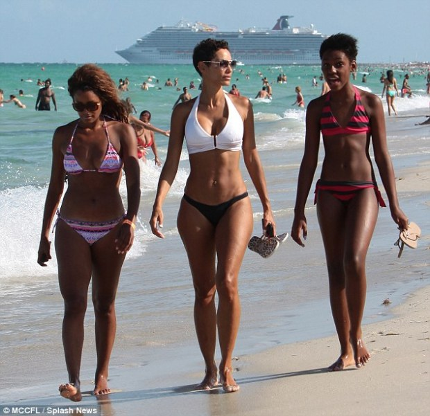 Girls day out: Nicole strolled the shores alongside her daughter Zola and her friend Claudia Jordan