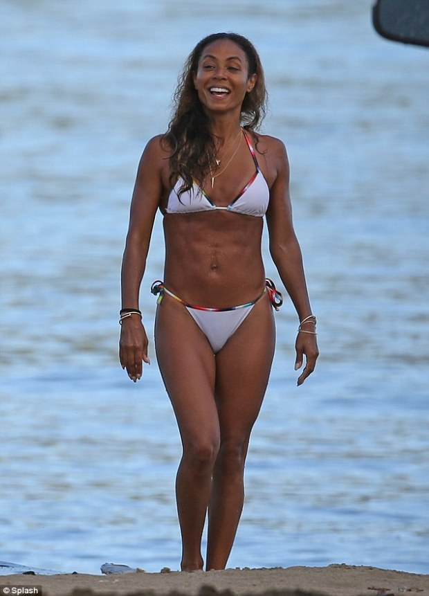Abs-olutley amazing: Jade Pinkett Smith, 41, showed off her trim and toned figure as she wandered around a beach in Hawaii on Friday