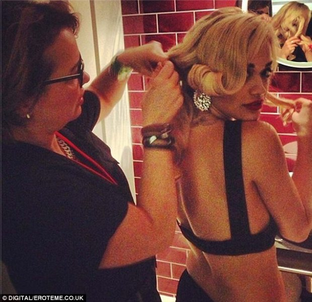 Mum's the word: The west London-born singer gets her mother to sort her hair backstage