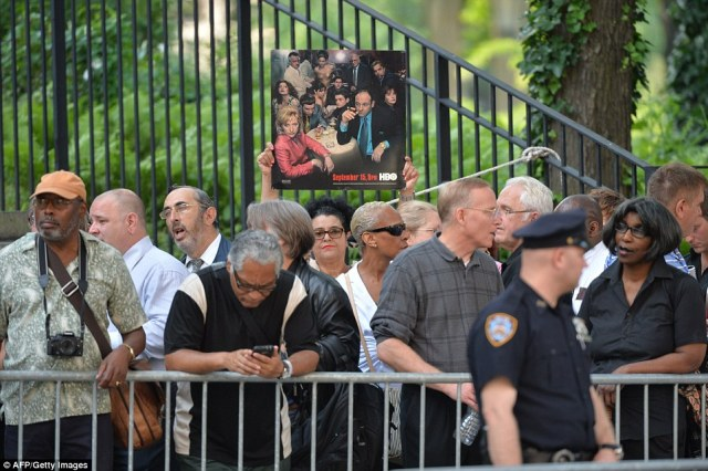 Fans: Mourners line up outside the Cathedral Church of St. John the Divine for funeral service for Gandolfini