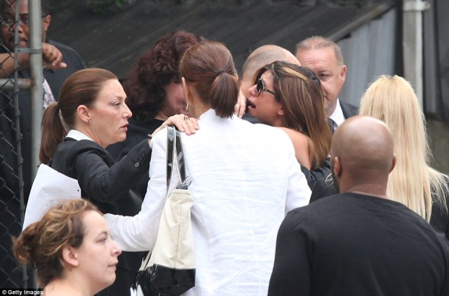 Overcome: Jamie Lynn-Sigler, breaks down after the funeral for James Gandolfini, her on-screen father in The Sopranos