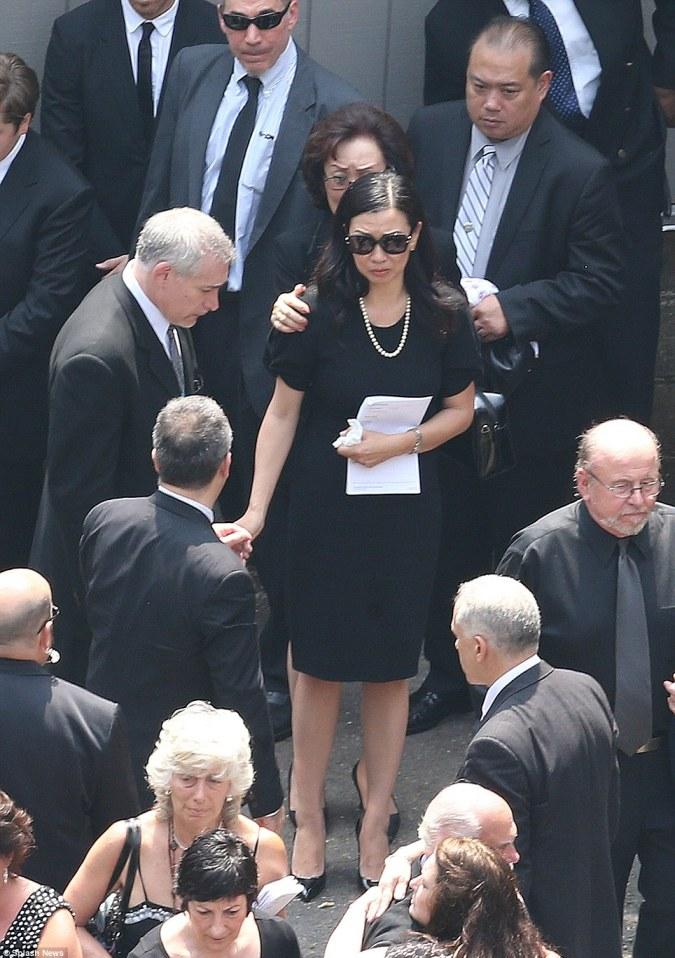 Shaken: James Gandolfini's wife, Deborah Lin, has to be held by family members at the funeral of her beloved husband