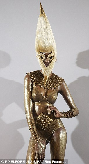 Creepy: Mask headdresses completely obscure these models' faces although that probably won't stop Lady Gaga