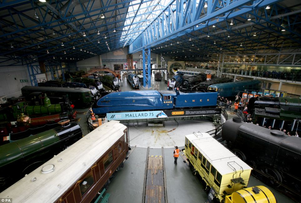 Full view: The Mallard being shunted into position around the turntable, along with the only other surviving A4 locomotives in the world as part of the 'Great Gathering'