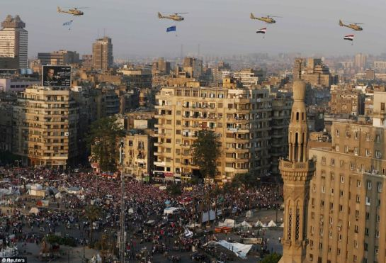 Skyline: A helicopter fly-past over protesters against ousted Egyptian President Mohamed Mursi, in Tahrir Square