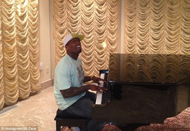 Joking around: 50 then sits at the piano and pretends to play it