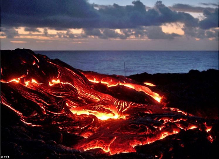 Scorching: The extreme photographer admits he takes risks as he plies his trade around the volcanoes of Hawaii, such as this one at Kilauea