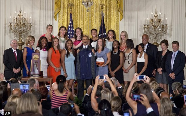 Festive occasion: The ceremony was held in the East Room of the White House to honor the Lady Huskies for their 2013 NCAA Women's Basketball Championship win
