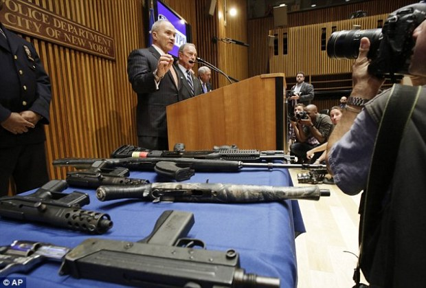 Off the streets: NYPD commission Ray Kelly with Mayor Michael Bloomberg, announcing the gun bust Monday