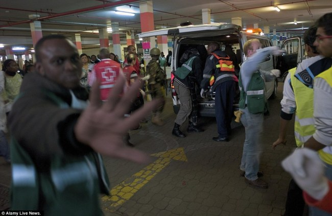 A wounded soldier is removed from an ambulance at an emergency staging area near the Kenyan mall where gunmen shot dead at least 40 people